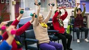 Aged care clients take part in a group exercise class