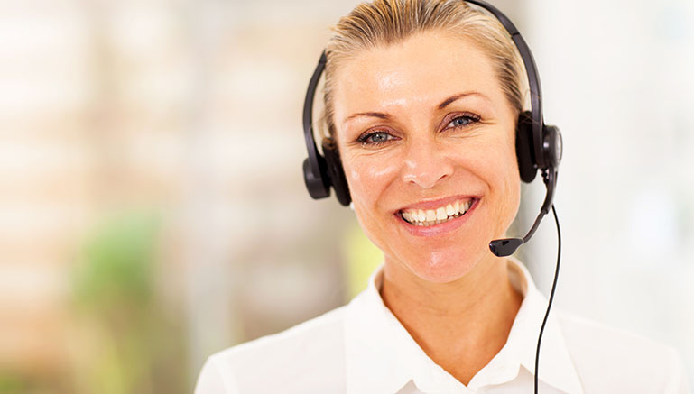 Stock image of a smiling telephone operator
